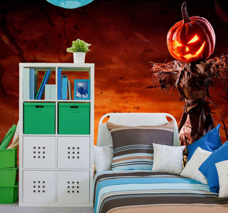 TenStickers. Scary pumpkin Halloween wall mural.  Scary pumpkin Halloween wall mural featured with a ghost pumpkin hanging on a scarecrow figure, the background is a red scary theme.