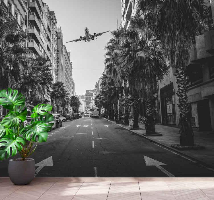 TenStickers. Fototapeta Samolot nad miastem. Ciesz się widokiem ulicy miasta w zaciszu swojego wnętrza dzięki tej dużej fototapecie przedstawiającej ulicę z samochodami. Jest realistyczna i uwielbiałbyś ją.