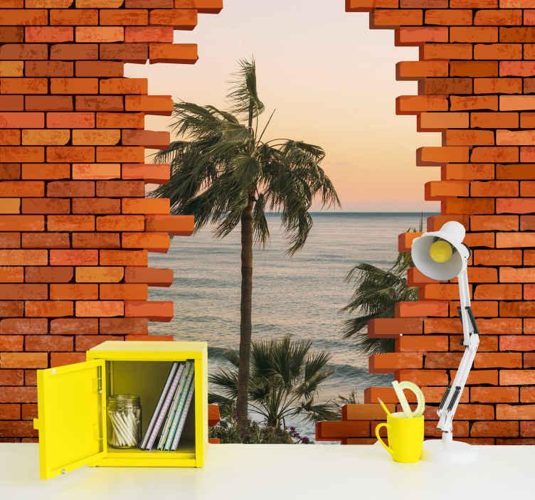 TenStickers. Fotomurais de Parede Buraco na parede com foto. fotomural vinílico de parede de paisagem 3d realista ilustrando uma vista panorâmica de uma praia através de uma parede de tijolos quebrada. . é fácil de aplicar e duradouro.