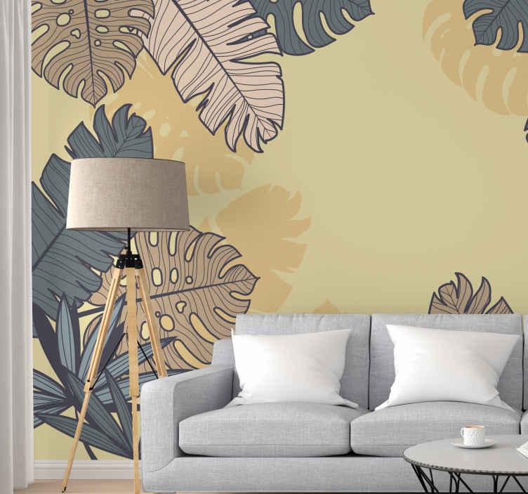 TenStickers. Fotomurali fiori Monstera giallo pastello. Foto fotomurale naturale con un grande disegno di foglie di albero, con colori beige e blu navy, perfetto per riempire con eleganza e natura le pareti