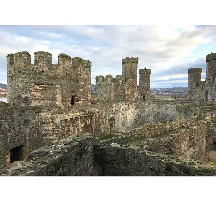 TenStickers. Conwy hrad nástěnná malba tapeta. Fantastická fototapeta městské hradby z hradu conwy, která se nachází v anglii, abyste si mohli užít dekorace, na kterou nebudete moci přestat dívat.