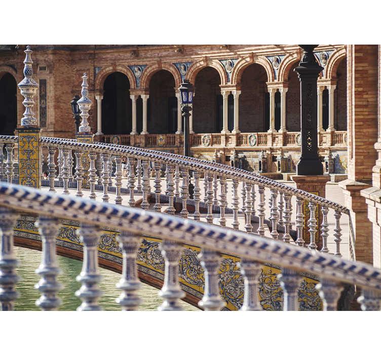 TenVinilo. Mural pared ciudad Sevilla Plaza España. ¡Fantástica ciudad de Sevilla con la Plaza España se verá genial en tus paredes! Nuestro fotomural de ciudad es una forma moderna de decoración.