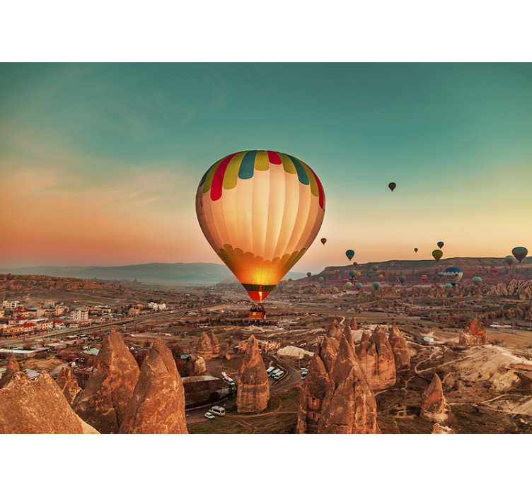 TenStickers. Hot Air Balloon landscape wall mural. A very beautiful cosy desert scene wall mural of multiple hot air balloon flying peacefully above the desert. See the balloons fly away and enjoy it.