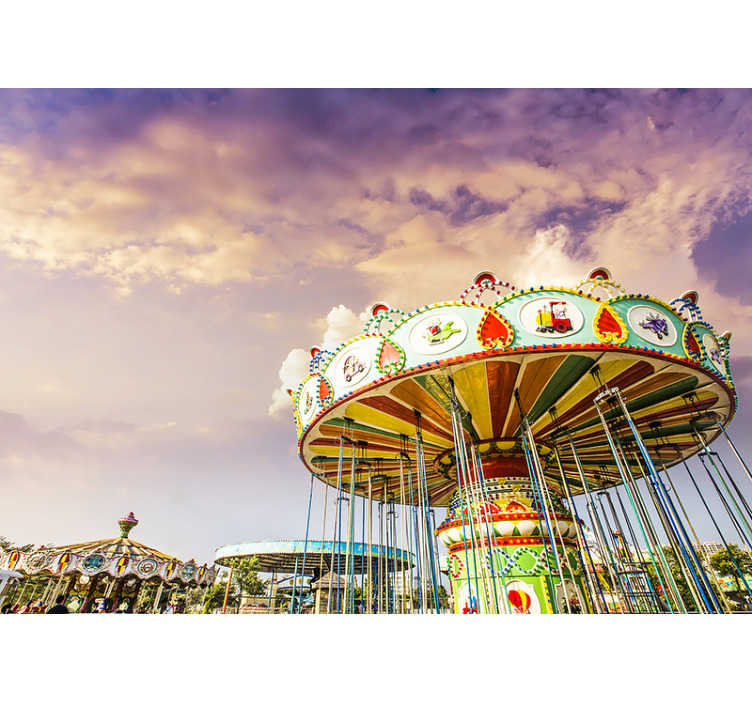 TenStickers. Vintage carousel photo wallpaper. A beautiful reproduction of a vintage carousel lounge wallpaper photo with an extra emphasis on the clouds that are beautifully depicted.