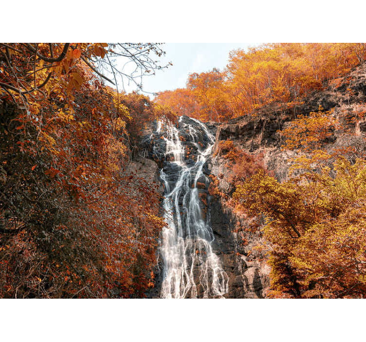 TenStickers. Autumn waterfall landscape wall mural. This beautiful phot wallpaper shows a waterfall in a forest in autumn The lovely and rich colors of orange and blue will look fantastic on your walls!
