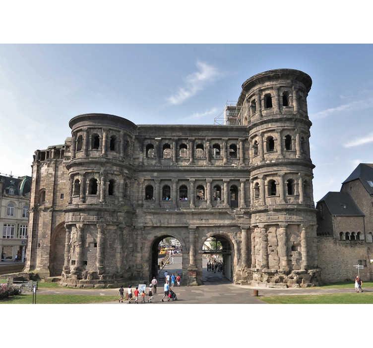 TenStickers. Porta Nigra Trier Fototapete. Was für ein wunderschöner Ausblick! Die Porta Nigra in Trier ist ein wunderschöner anblick, den Sie in dieser Stadt Fototapete bewundern können. Sehr einfach anzuwenden.