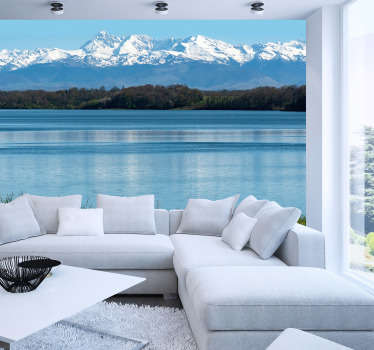 A stunning mountain wall mural of the Pyrenees. Nestled below is a beautiful blue lake with the snow covered moutains standing tall above it.