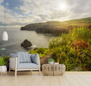 An Azores at Dawn landscape wall mural design that contains massive low rocks on the sea with the sun casting upon it in it fullness with the sky.