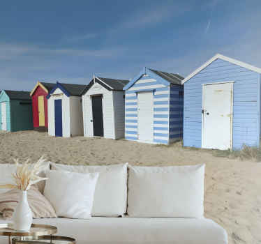 Order this high quality scenery photo mural that shows a row of colorful beach huts. High quality of the ink and matte finishing.