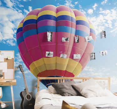 A large colourful vintage air balloon wall mural that is created with a beautiful atmospheric blue sky that will change the look of your wall at home.