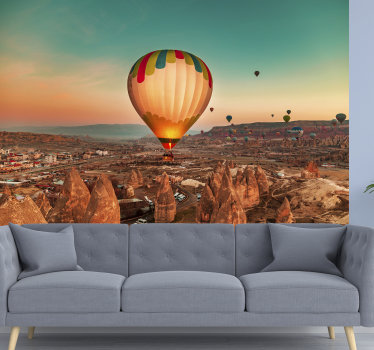 A very beautiful cosy desert scene wall mural of multiple hot air balloon flying peacefully above the desert. See the balloons fly away and enjoy it.