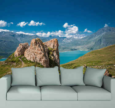 In the distance you can enjoy the beautiful blue sky, the clouds and the mountain areas. This is the perfect scenery photo mural to take in your home!