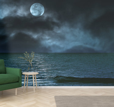Spectacular sea wall mural with an image of the sea illuminated by the full moon that can be seen between the clouds perfect for your living room.