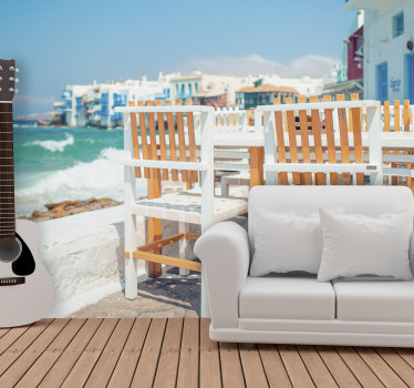 Relax and enjoy the peace in your house while admiring this stunning scenery wall mural of a sea view from a greek coffee house.