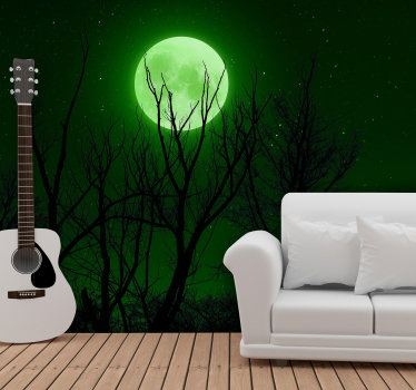 Magnificent landscapes wall mural with a photo of the night sky with a majestic green moon illuminating the forest, perfect for your living room.