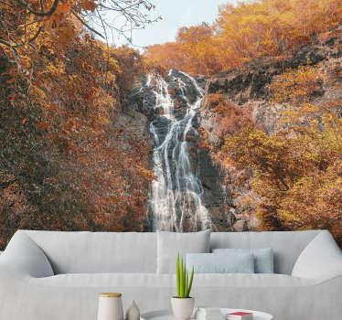¡Este mural para pared de paisaje muestra una cascada en un bosque en otoño, los hermosos y ricos colores naranja y azul se verán fantásticos en tus paredes!