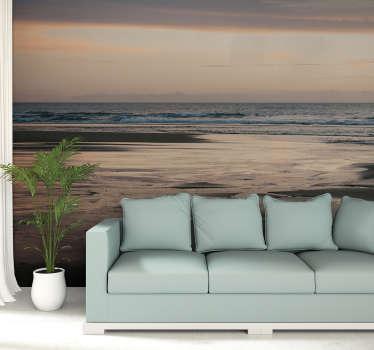 Como seria bom sentar na areia quente e olhar o sol. Com este grande mural de parede decorativo do mar da Praia da Caparica é quase possível.
