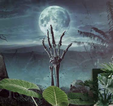Skummelt dekorativt halloween veggmaleri design med et øde landskap med grav og skjeletthånd som stikker fra graven.