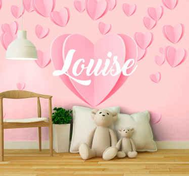 Peintures murales personnalisées coeur rose. Ce sticker a un grand coeur avec un nom personnalisable au milieu et des petits coeurs au dessus!