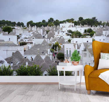 Nástenná maľba v obývacej izbe s krásnym obrazom dediny alberobello v taliansku a ohromujúcich domov trulli.