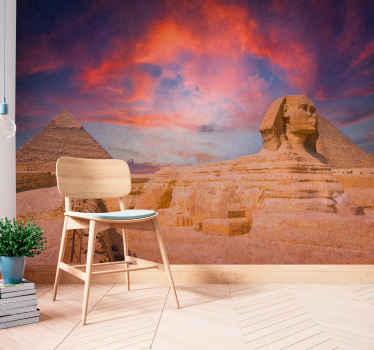 The Great Sphinx of Giza with a sunset wall mural. Colourful sunset with the sight of the great pyramid and Sphinx of Giza. Get immediate shipping!