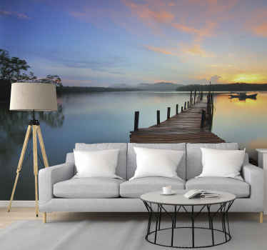 Why not purchase this amazing lake scenery wall mural with  wooden bridge for crossing. It presents a beautiful blue sky with sunset closing up.