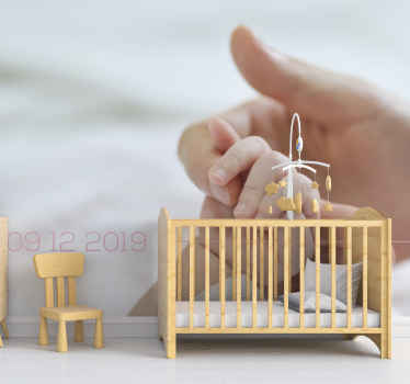 Personalisable baby birth date nursery room photo wall mural displaying the image of an adult hand holding a baby's hand.