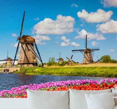 Jetez un œil à cette magnifique stickers photo inspirée des moulins à vent emblématiques des pays-bas avec des fleurs colorées et un ciel bleu.