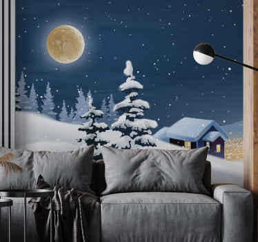 Wall mural design of typical Christmas winter having a house and mountains covered in snow and the appearance of the full moon in the sky with stars.