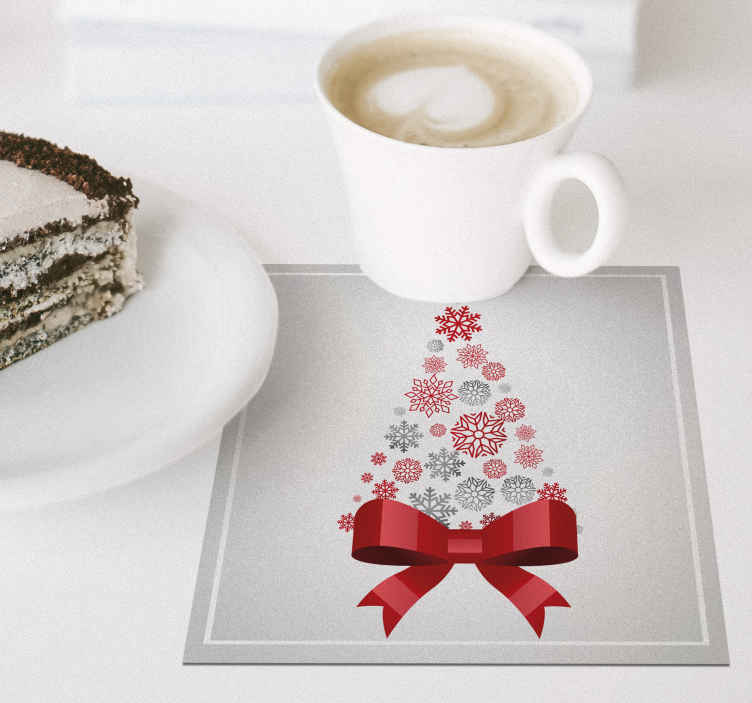 TenStickers. Elegant Christmas tree drink coaster. Beautiful and elegant Christmas drink coaster featured with red ribbon and other ornamental Christmas featured. It is easy to maintain.