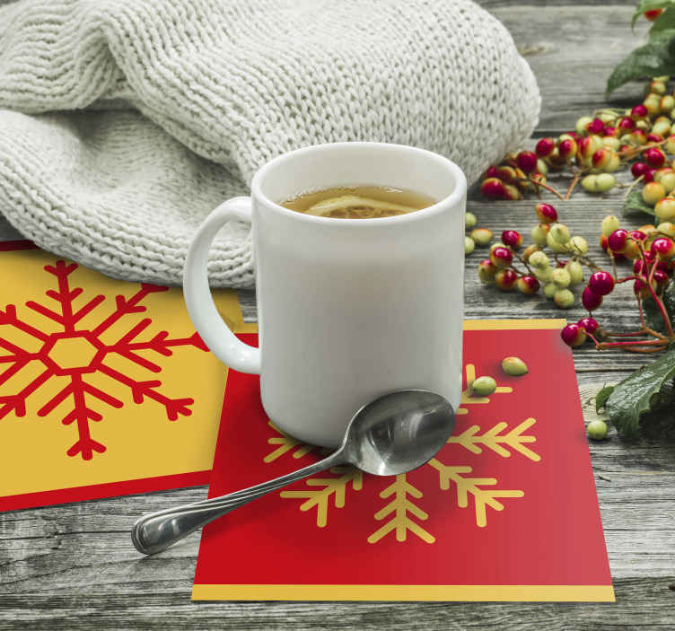 TenStickers. Christmas Snowflakes drink coaster.  Christmas snowflakes drink coaster design,  a red colour background design with ornamental snow flake design. Available in different packs.