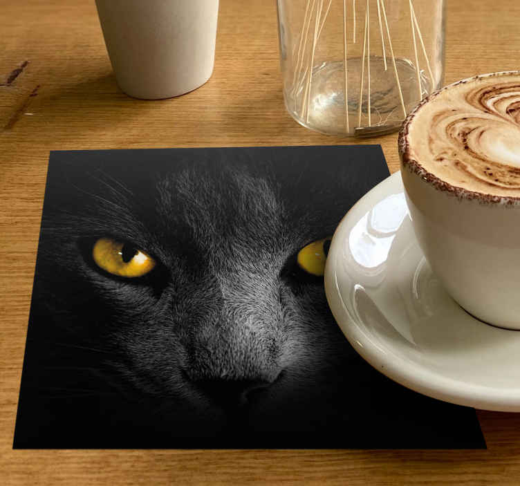TenStickers. Black cat halloween coaster. This cat coaster design features a realistic black cat up close with glaring orange eyes. High quality vinyl materials used.