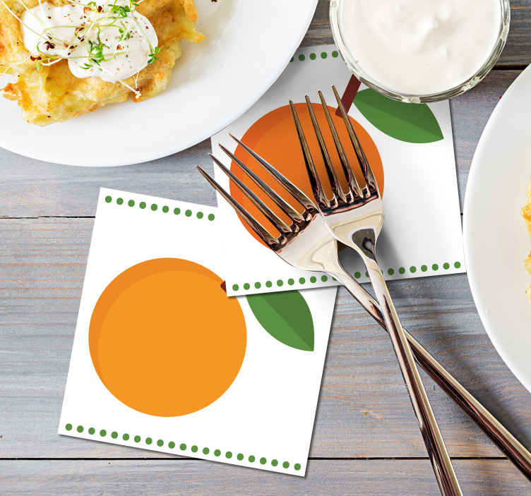 TenStickers. Cartoon art orange citrus coaster. Orange drink coaster which  features an image of a cartoon orange with a spotted green border. The design has a white background.