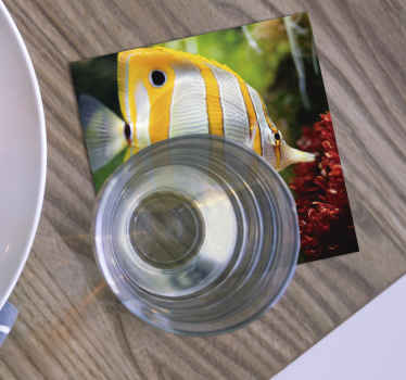 Awesome fish coaster that has a yellow and white fish swimming in clear water. Easy to keep clear. Waterproof. Top-quality.