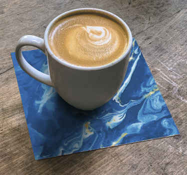 Beautiful blue watercolor effect modern coaster to serve all your beverages, coffee  and tea. Easy to maintain and made of high quality vinyl.