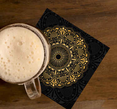 Gold mandala patterned drink coaster made with ornamental flower design on black background. It is made of good quality.