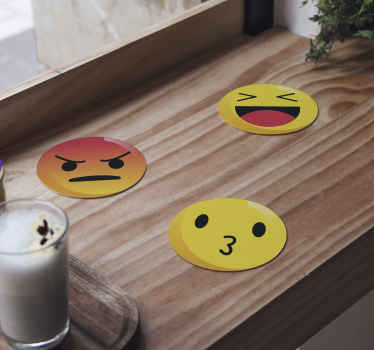 An amazing emotion icon drink coaster to enjoy all your drinks in the home. It design is made on a yellow background with emotion icon on it.