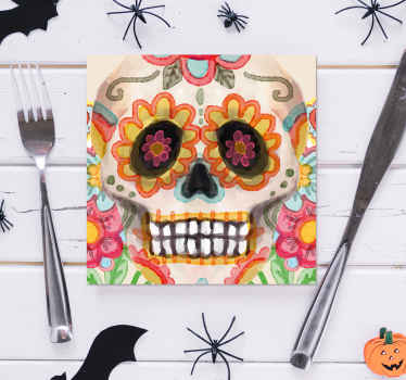 A multicolored Halloween drink coaster with a Mexican skull design. It is made from high quality material and easy to maintain.