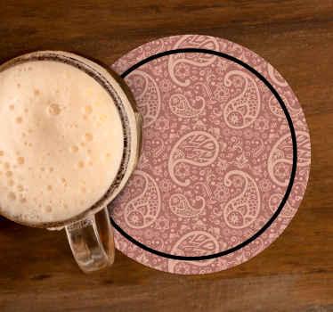 Sous-verre rond avec motif paisley sur fond coloré. Il est facile à entretenir et fabriqué à partir de matériaux de haute qualité.