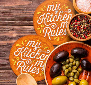 Orange coaster set which features the text 'my kitchen my rules' coloured in orange and yellow. High quality materials used.