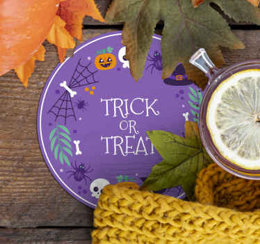 A round drink coaster design with a purple colour background.  On the design is inscribed trick or treat. Made of high quality material.