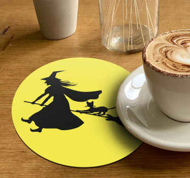 Yellow round drink coaster with a black flying witch design.  An Halloween inspired design to serve guest and friends all your amazing drink .