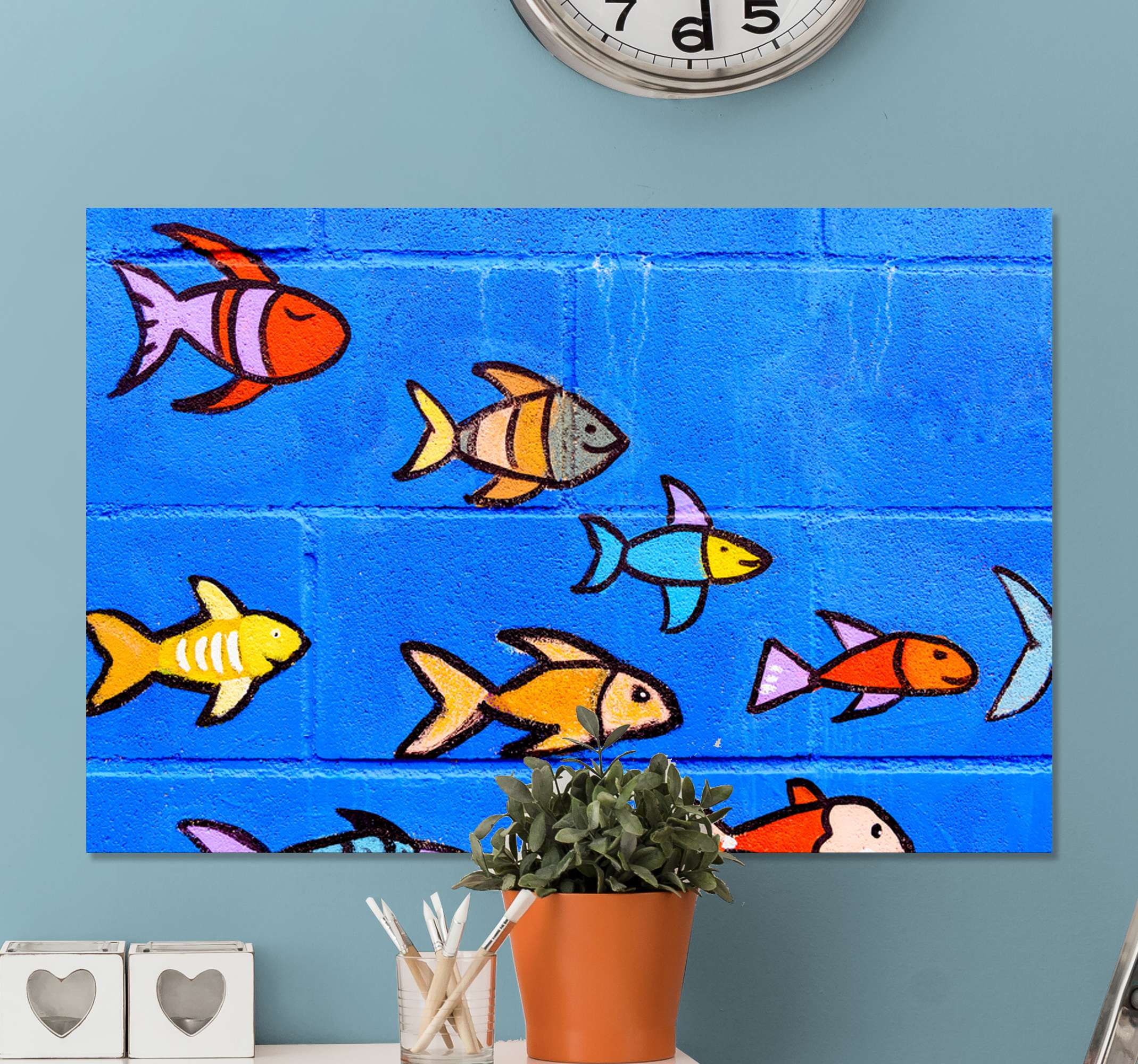 TenStickers. Brick Wall Ocean canvas print. Fish canvas print which features a group of drawn fish all swimming together and smiling in the ocean. High quality materials.