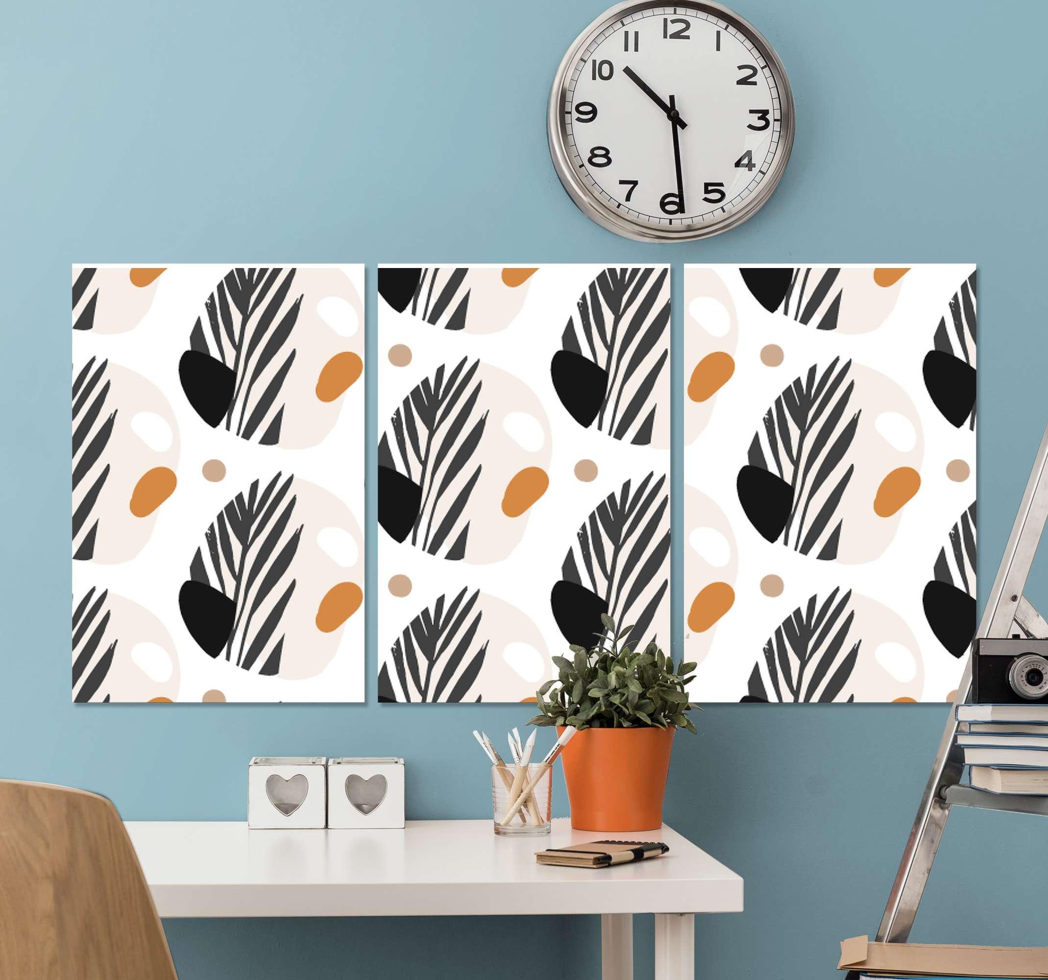 TenStickers. Scandinavische bladeren canvas schilderen . Noordse canvas schilderij met een patroon van abstracte vormen gekleurd in zwart, oranje, bruin, grijs en wit. Kortingen beschikbaar.
