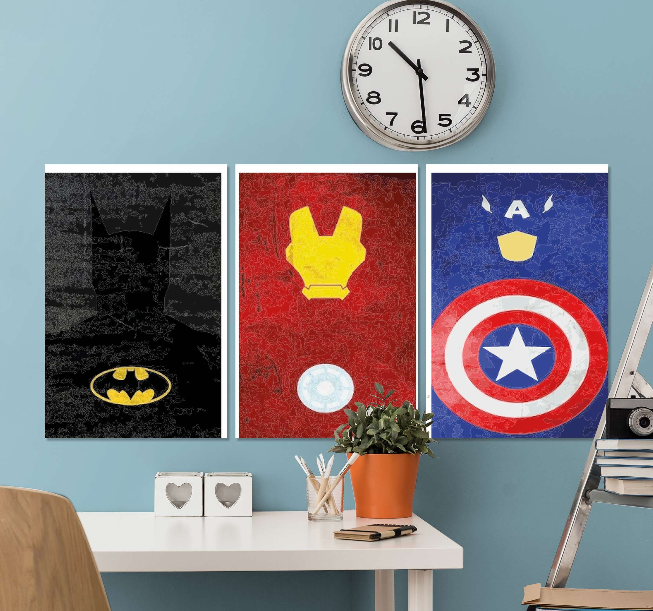 TenStickers. Superhéroes Populares superhero framed wall art. Canvas print with superheroes. It shows logos of different superheroes such as Baatman, Captain America and others. You can hung it easily.