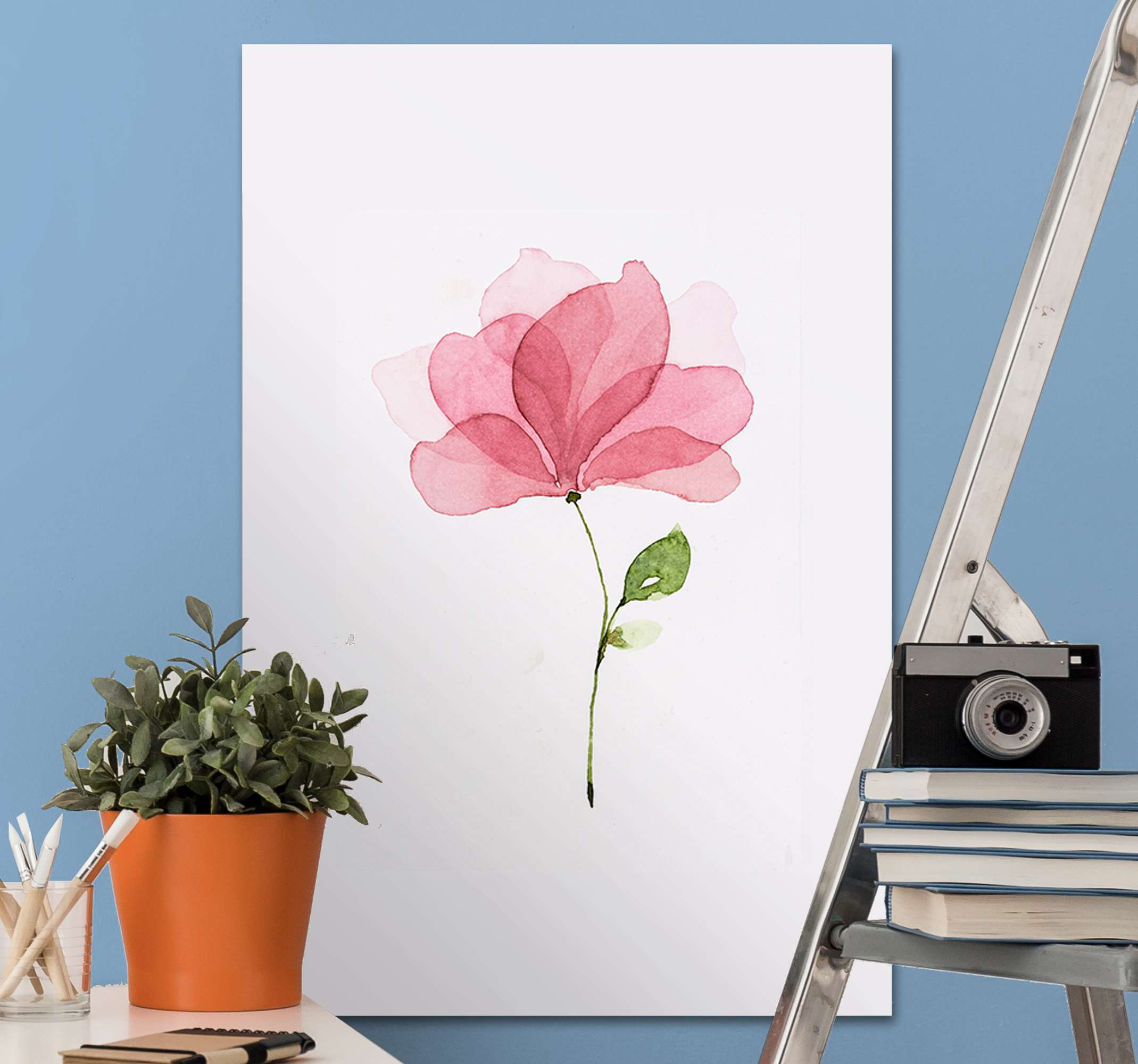 TenStickers. Watercolour Pink Flower wall prints. Pink flower canvas wall art which features an image of a single pink flower which looks like it has painted with watercolours.