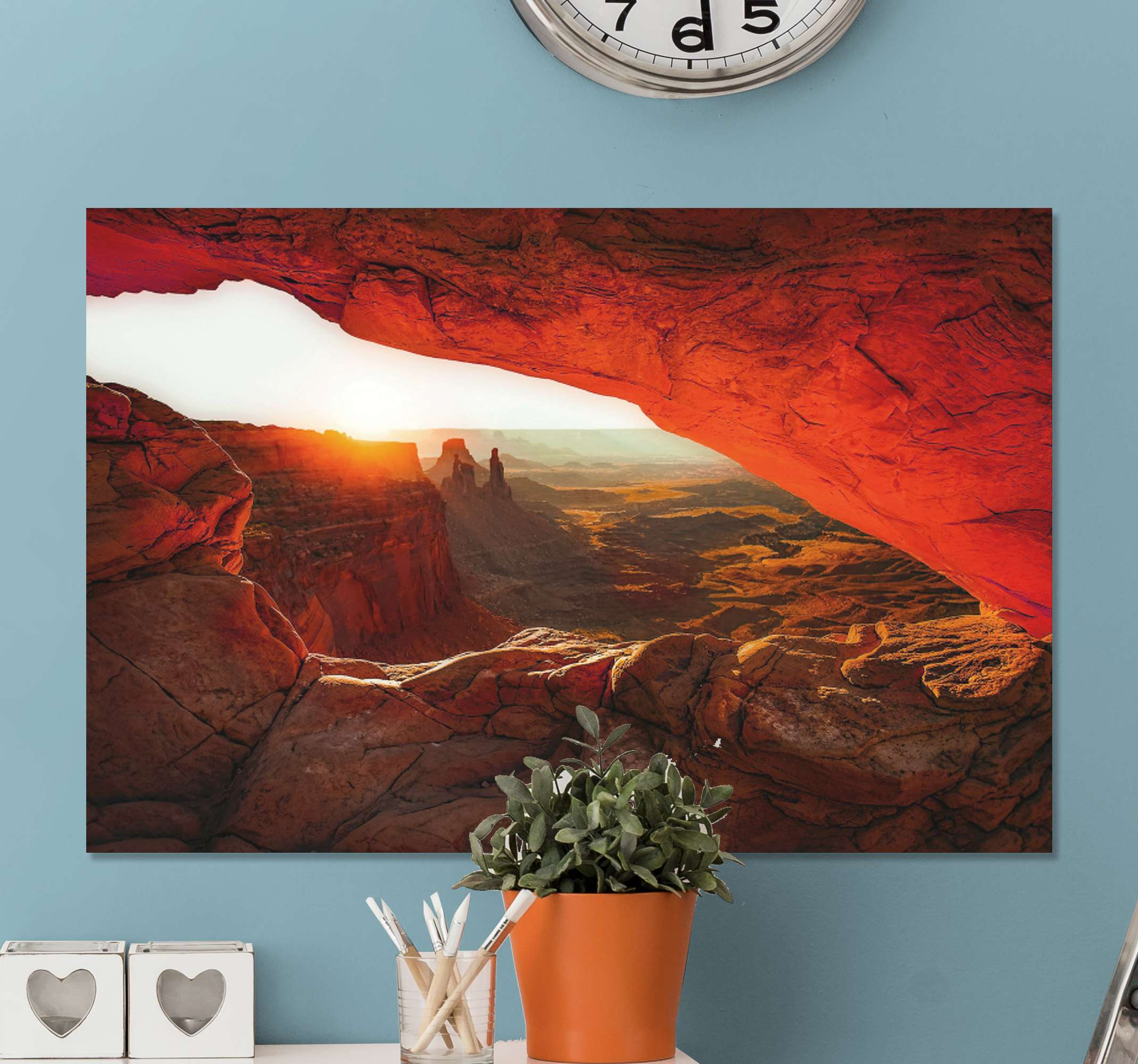 TenStickers. Rocky Desert Sunset landscape wall art. Landscape canvas print which features a stunning image of a rocky desert landscape with the sun setting in the distance.