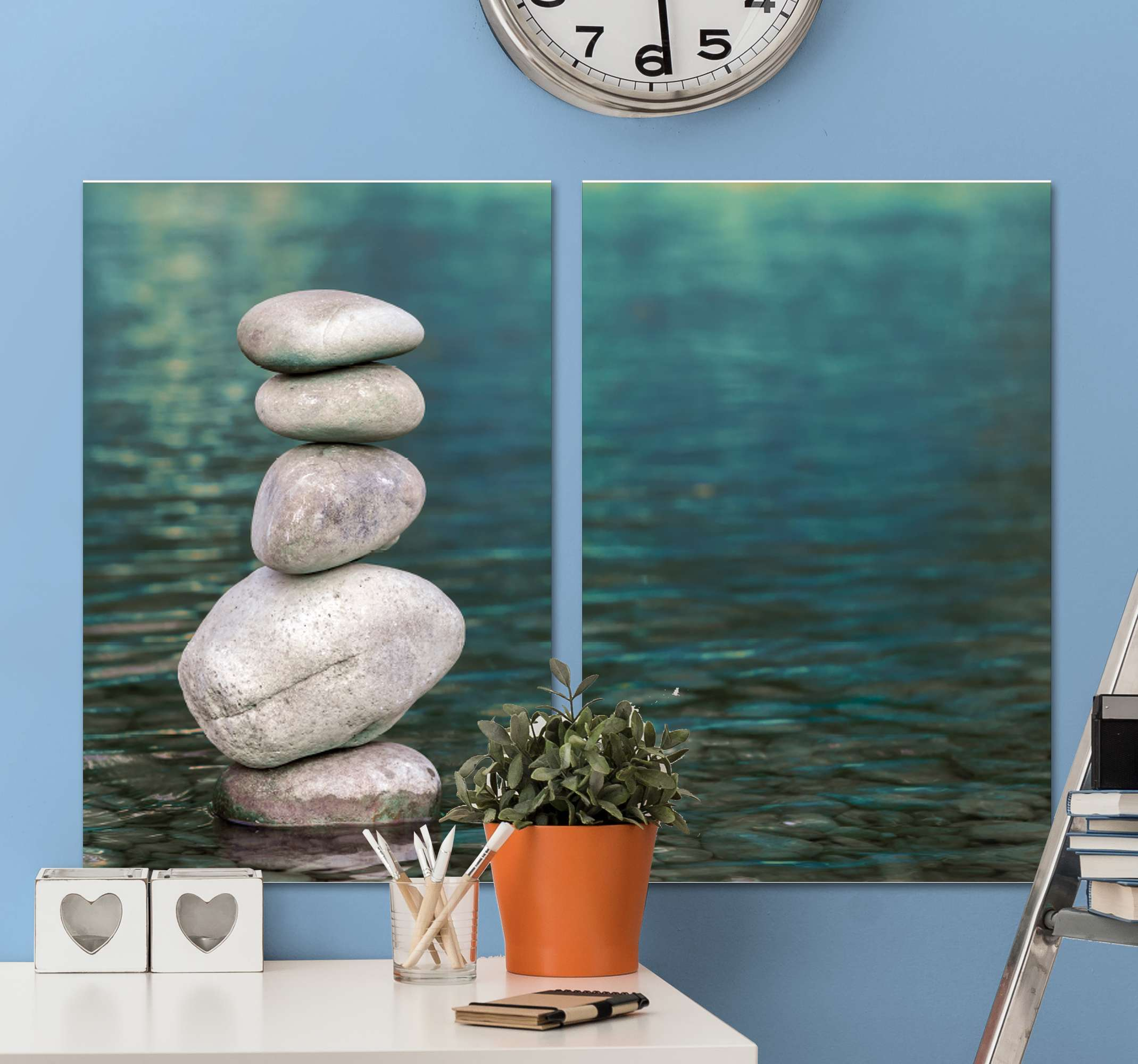 TenStickers. Zen Stone Pile canvas wall art. Zen canvas wall art which features an image of a pile of 5 pebbles all stacked on top of each other in a body of water. Choose your size.