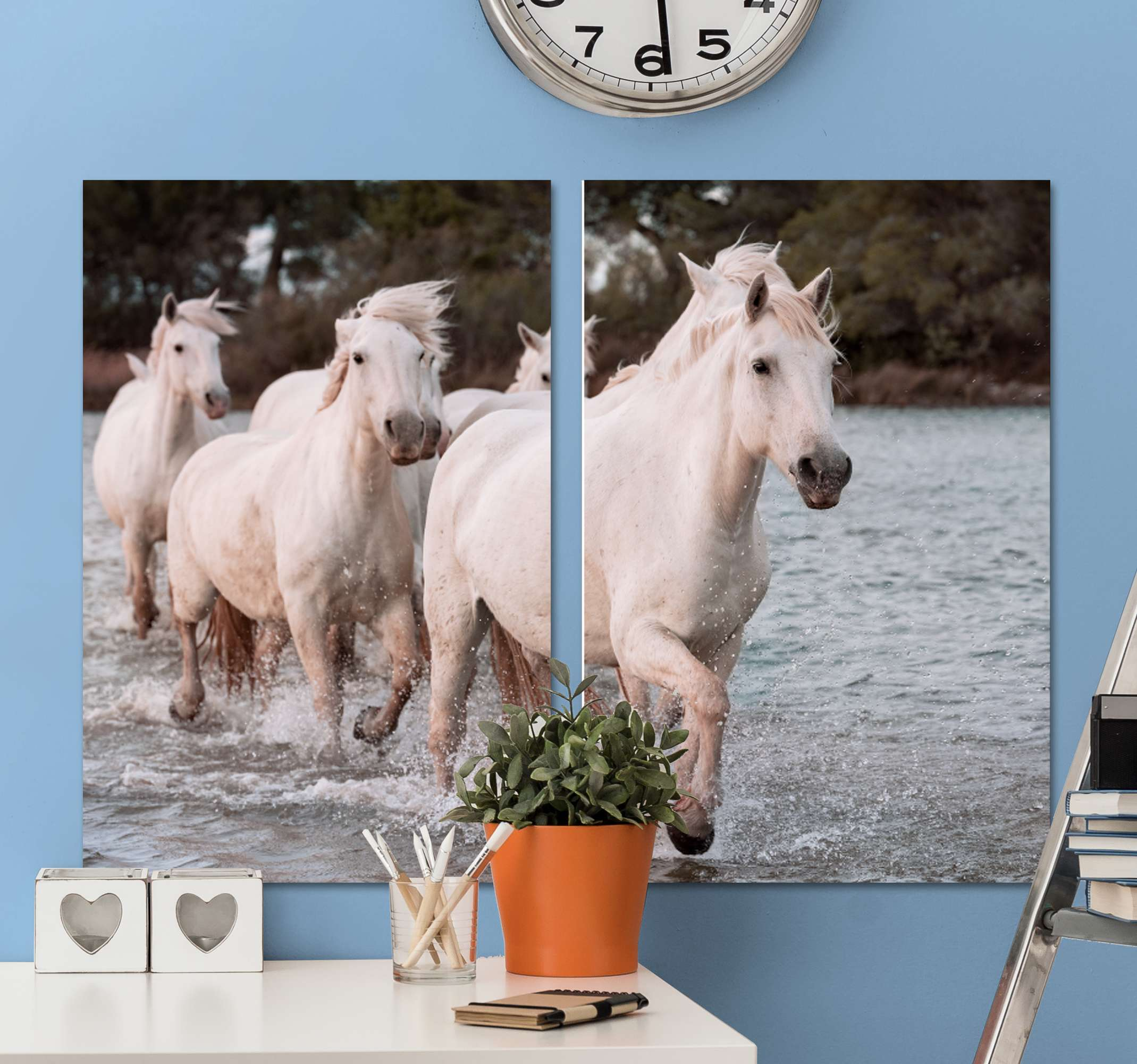 TenStickers. White Horses running Canvas Print. Horse canvas print which features an image of a group of white horses running through the water with a forest in the background.