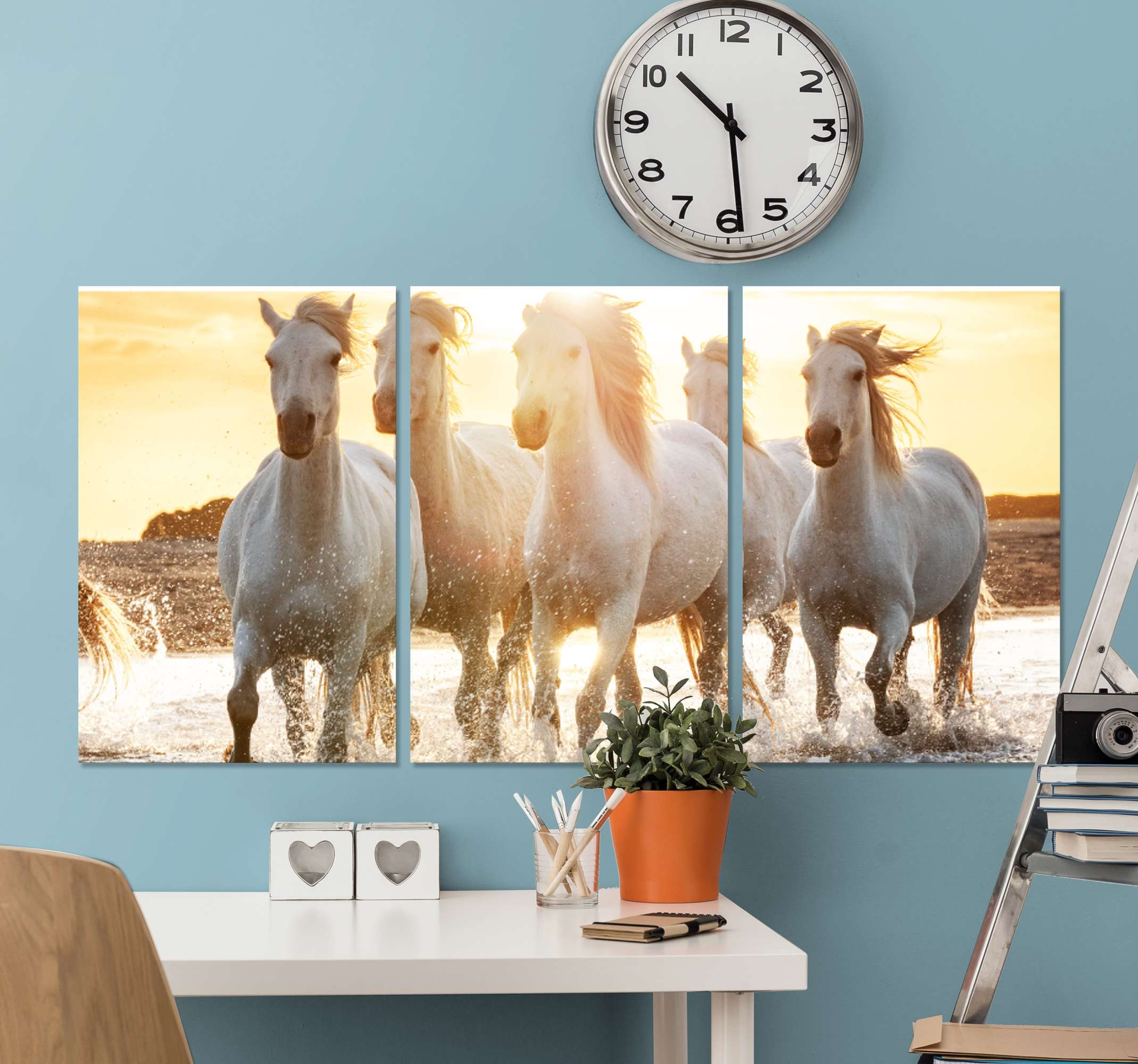 TenStickers. Herd of white horses canvas print. Horse canvas print which features a stunning image of a herd of white horses running through a river in the sunset. Available in various sizes.